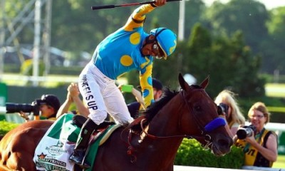 Victor Espinoza, celebrates atop American Pharoah after winning the 147th running of the Belmont Stakes on June 6, 2015 (Al Bello/Getty Images)