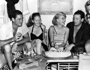 Rita Hayworth with Orson Welles, Errol Flynn and Nora Eddington