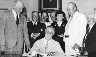 President Roosevelt signs Social Security Act