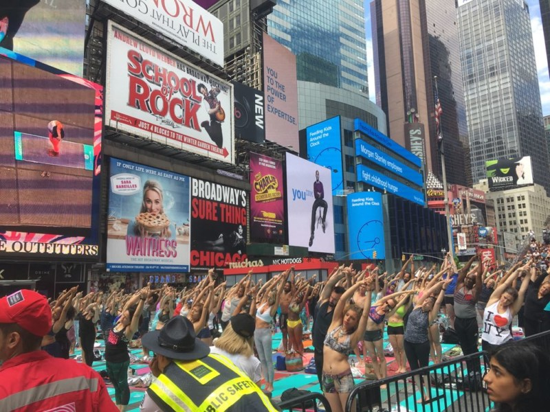 Mind over madness yoga a peaceful sit in in times square for Activities in times square